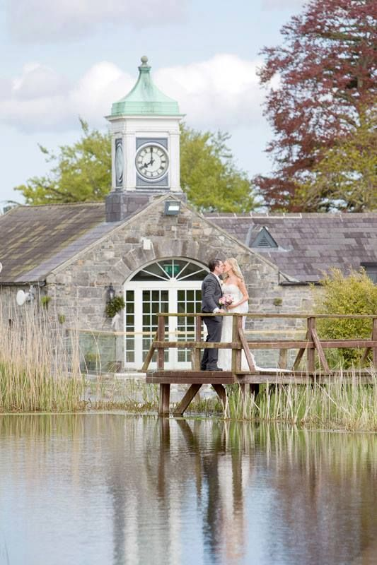 A wonderfully romantic image of a couple on the bridge at Ballymagarvey Village