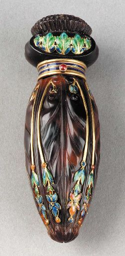 A TORTOISE-SHELL AND ENAMELED 18 KARAT GOLD PERFUME FLASK**   Tiffany & Co., circa 1905   with original fabric box   3in. (7.6cm.) long   the flask stamped TIFFANY & CO. with French 18K gold poinçons, the inside of the box marked TIFFANY & CO. 36 bis AVENUE DE L'OPERA PARIS | JV