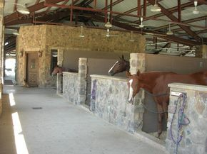 Barn with stone stalls( ill probably never build a horse barn but wow this is how I'd want one)