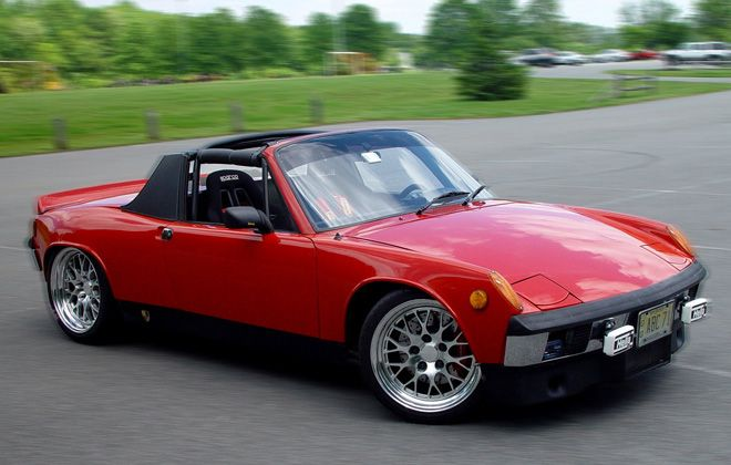 My 4th car: 1976 Porsche 914. Started out with the flat 4 and a 4speed stick. Ended up with a Pearl White carbon/Kevlar full convertible body, carbon removable hard top, custom 3 piece aluminum wheels, 930 brakes, custom leather/Alcantara interior and a bridge ported 13B turbocharged Mazda rotary engine with a 100hp nitrous injection. 380hp to the wheels! My favorite!