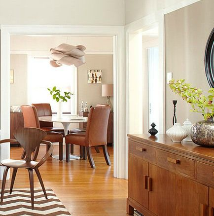 best gray paint colour revere pewter by benjamin moore shown in dining room with fir wood flooring