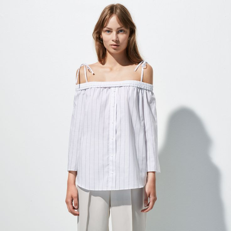 FWSS Corner is a cotton off-the-shoulder shirt with stretch shoulders and adjustable tie-up shoulder straps.
