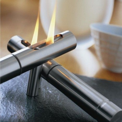 Table top fireplaces small, stylish, romantic and they generate HEAT. Very cool design with tanks in the handle.
