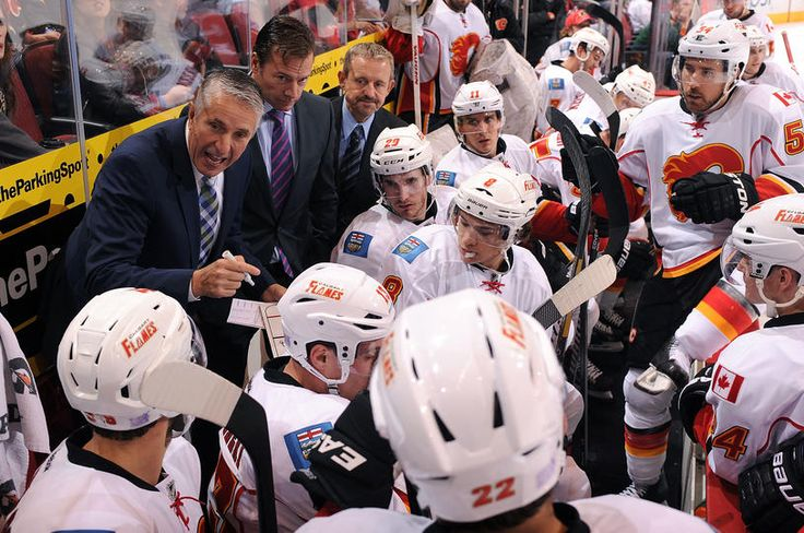 GLENDALE, AZ - OCTOBER 22: Head coach Bob Hartley of the Calgary Flames talks to his team during a timeout against the Phoenix Coyotes during the third period at Jobing.com Arena on October 22, 2013 in Glendale, Arizona.