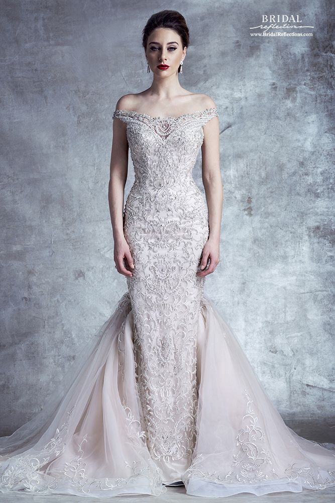 Stephen Yearick Wedding Dress and Bridal Gown Collection  How Exquisite is this sheath dress with mermaid skirt added at sides and back? The embroidered embellishment is absolutely divine. Romantic and ever so elegant.