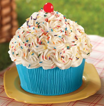 CUPCAKE CAKE: with Rounded top + Frosted in SWIRLS with Cream Cheese Frosting OR Whipped Cream + Topped with Colorful Sprinkles + and CHERRY!