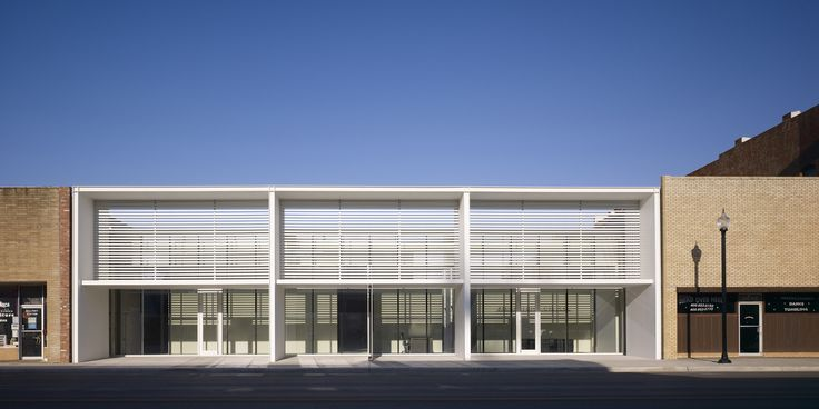 Modern facade with screening, scaled to fit within old streetscape.