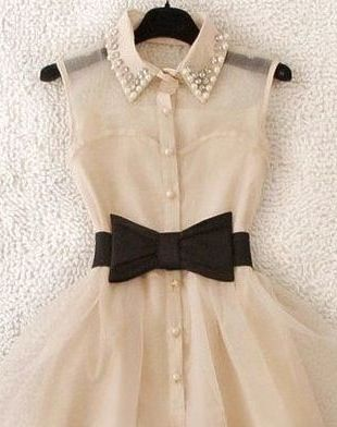 pinner said-Vintage chiffon dress with black bow belt... Needs to be worn with black camis, statement necklace with bracelet if long hair wear in bun.