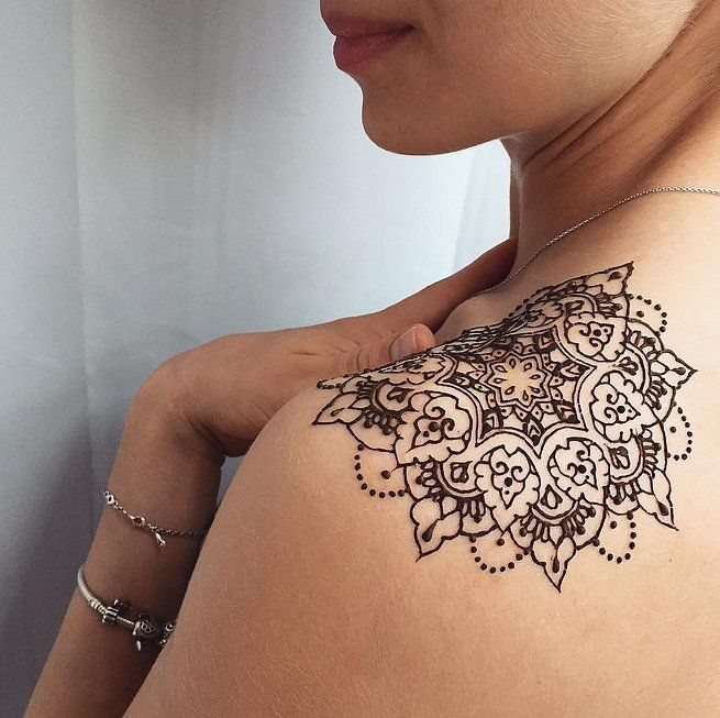 Who needs permanent ink when you can get a flashy henna tattoo?