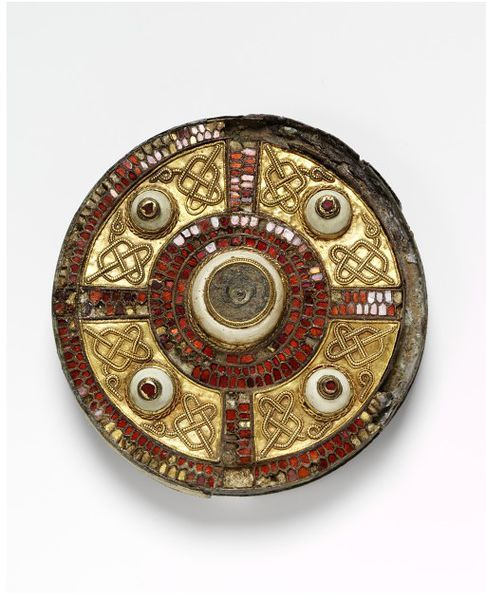 The Milton Jewel is one of the finest examples of Anglo-Saxon brooches of the period, with a sophisiticated design carried out in a combination of materials.The use of cloisons inlaid with garnet, filigree knot work decoration on gold sheet and shell bossess are typical of this type. The brooch was found in 1832 in a cemetery at Milton, west of Dorchester-on-Thames. There is another similar brooch in the Ashmolean Museum, Oxford, which was found nearby.: Anglo Saxon Brooches, Brooches Decor, Anglosaxon, Milton Brooches, Disc Brooches, Anglo Saxon Jewelry, Albert Museums, Brooches Disc, 7Th Century