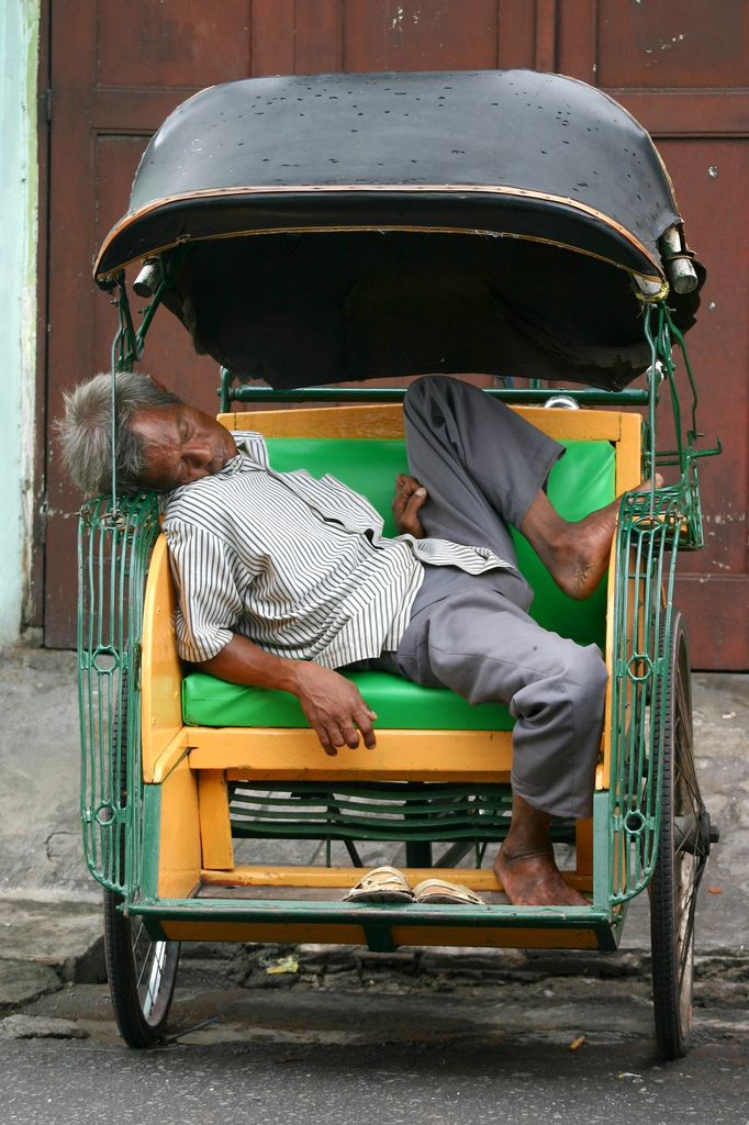INDONESIA - sleeping in a becak