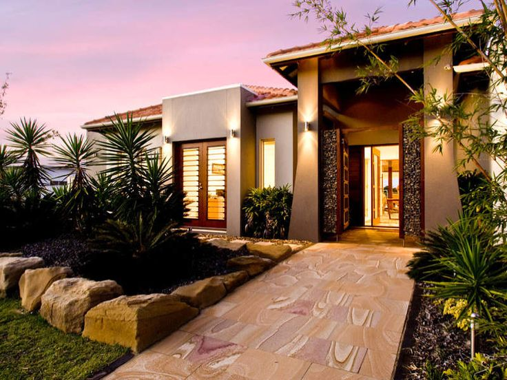 Concrete modern house exterior with french doors & landscaped garden - House Facade photo 217472