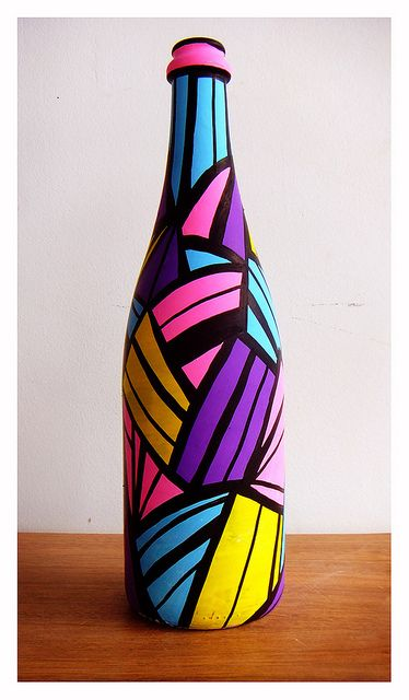 brightly decorated wine bottle ... upcycling at its best ...