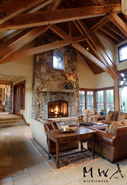 Great Room Granite Fireplace High Windows Wood Trusses