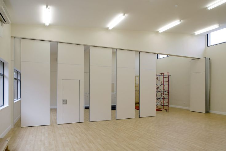 This acoustic partition operable wall was perfect to for Retractable walls commercial