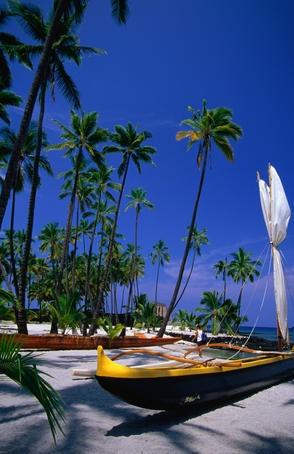 Outrigger canoe on the sand at Puuhonua o Honaunau (Place of Refuge) on the South Kona Coast.#hawaii