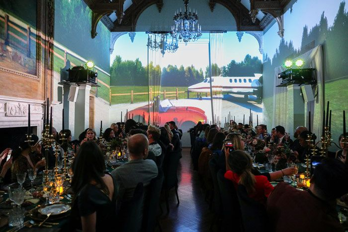 The four-course seated dinner was enhanced by animated wall projections that depicted various environments and scenarios inspired by the...