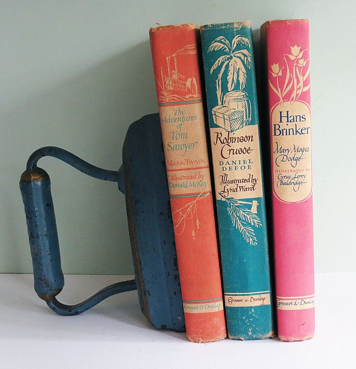 """I love this old iron as a bookend. This blog post from The T-Cozy is called """"For the Love of Vintage Books."""""""