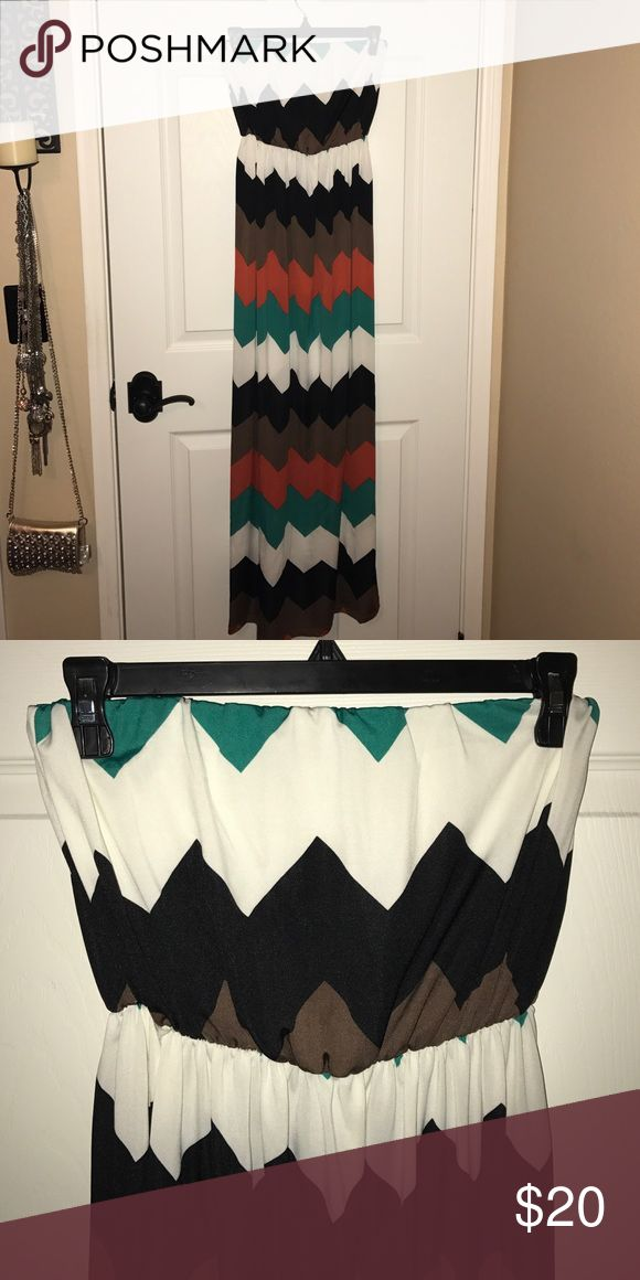 Women's Long Chevron Strapless Dress PRICE DROPPED!!! ••DISCOUNTED SHIPPING FOR THE NEXT HOUR•• Women's long Chevron patterned Strapless dress from Charlotte Russe; in GREAT condition; only worn a couple of times; elastic around the top of the dress is still in working condition; 100% polyester; the colors on the dress are: black, brown, white, green, and a orange/red color Charlotte Russe Dresses Maxi