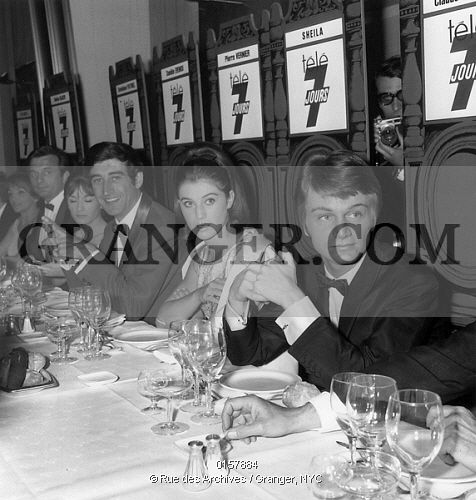 This is a Granger licensable image titled 'PIERRE VERNIER, SHEILA AND CLAUDE FRANCOIS.  Pierre Vernier, Sheila and Claude Francois during a diner at Hilton Hotel, Paris, on may 25, 1966. Full credit: AGIP - Rue des Archives / Granger, NYC -- All rights reserved.' by Granger, NYC All rights reserved. You may not copy, publish, or use this image except for sample layout ('comp') use only. You must purchase the image from Granger in order to use it for ANY other purpose.