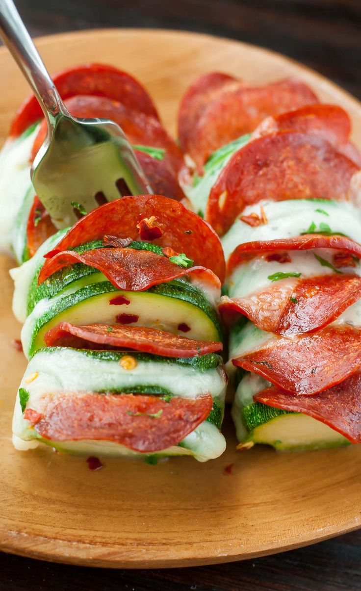 Skip the crust and grab a zucchini! These Cheesy Hasselback Zucchini Pizzas are guaranteed to impress and SO easy to make! low-carb and gluten-free