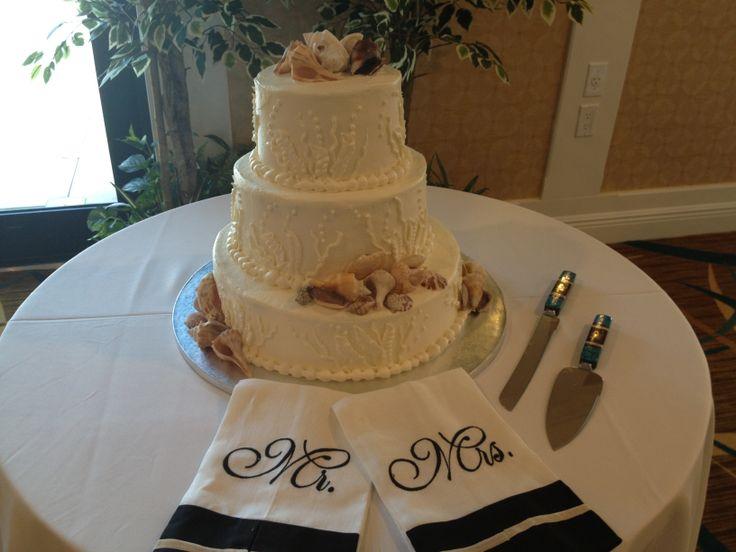 Seashell and coral decorated wedding cake sanibel Sundial Resort