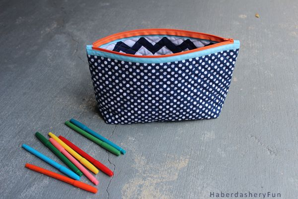 Easy zipper pouch sewing tutorial. Use colorful bias tape along the zipper for pops of color. Double sided quilted cotton no lining needed.