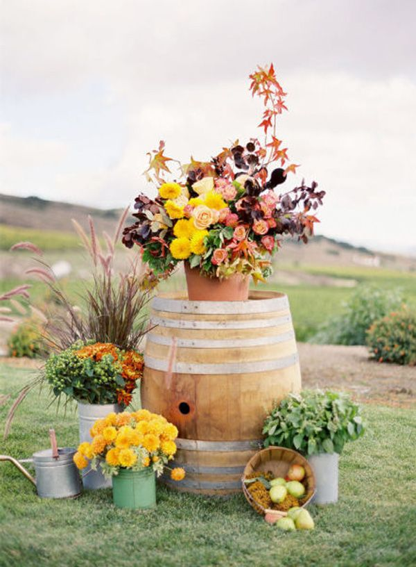 festive arrangement • outdoor wedding | event • wine barrel • floral design - Another idea for decorating outdoors for a country wedding.
