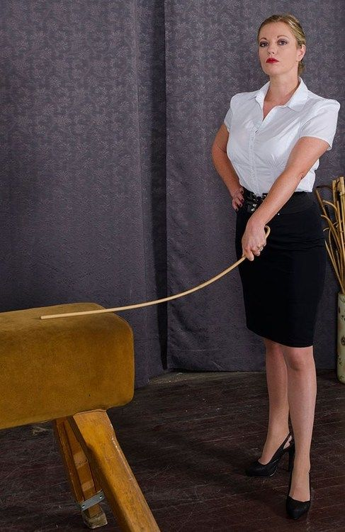 image Two femdom mistresses cane bound male to his knees