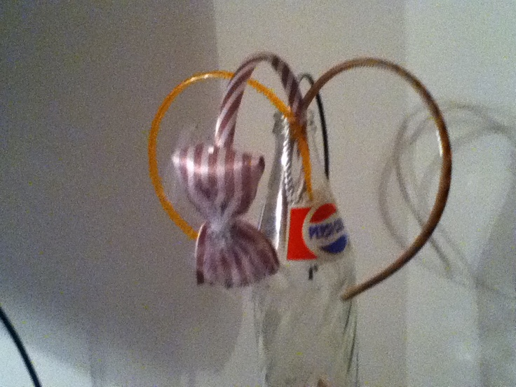 Use an old Pepsi or coke bottle to hold your fav headbands!