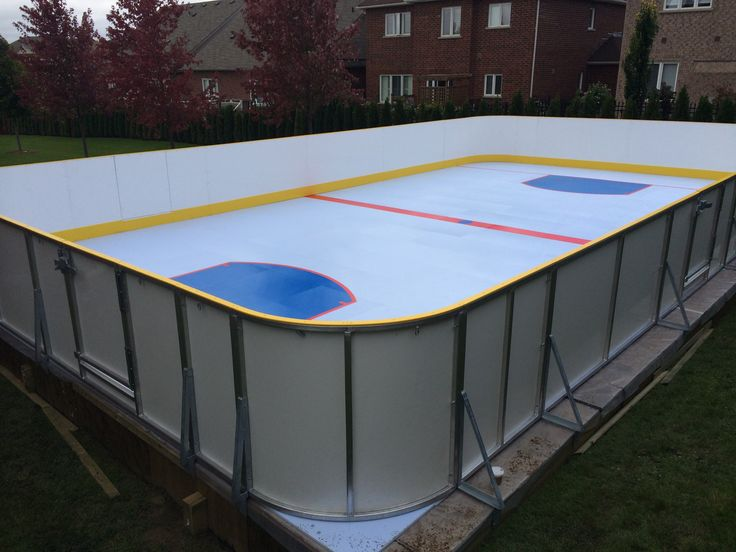Backyard hockey rink that can be used in every season. Smart Rink synthetic ice and boards supplied by SkateAnywhere.ca. September 2014.