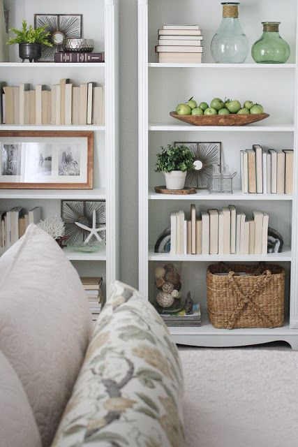 white bookcases on white walls and staging the shelves Made By Katy: our home