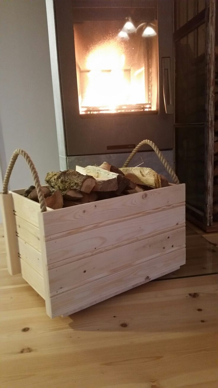 Wodden box for fire wood with rope handels.