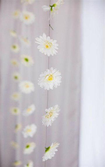 Would love a little gazebo with daisy chains hanging down off it  http://gazebokings.com/luxury-metal-framed-garden-party-gazebos/