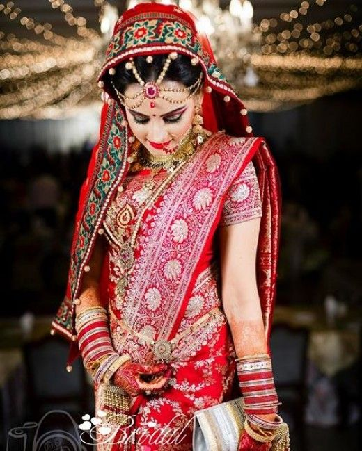 Exquisite standing pose by Bangladeshi Bride in lovely katan saree