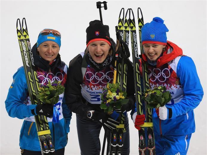 Sochi 2014 Day 3 - Biathlon Women's 7.5 km Sprint (L-R) Bronze medalist Vita Semerenko of Ukraine, gold medalist Anastasiya Kuzmina of Slovakia and silver medalist Olga Vilukhina of Russia pose after the flower ceremony after the Women's 7.5 km Sprint