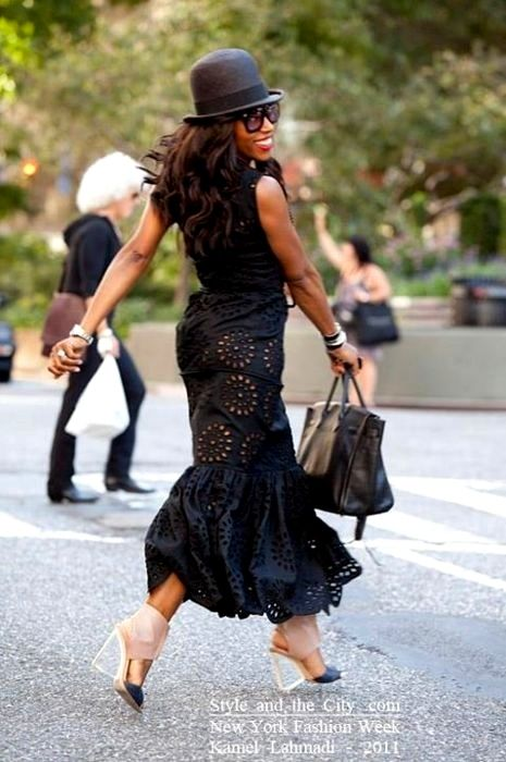June Ambrose in a gorgeous eyelet maxi, accented w/shoes & hat.