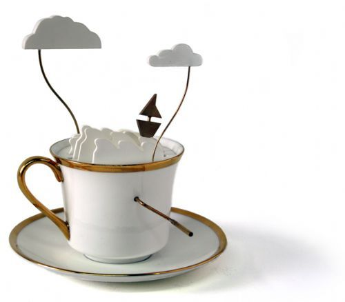 Storm in a Tea Cup by John Lumbus for Laikingland.  The Storm in a Tea Cup pays homage, in a very literal sense, to the famous idiom meaning a small event that has been exaggerated out of all proportion.    Turn the handle and the golden boat rides the mechanical waves, above the stormy clouds periodically reveal a shining bolt of lightning.