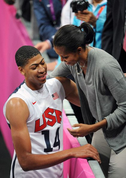 First Lady Michelle Obama gives a hug to Anthony Davis after the USA Men's Basketball team defeated France