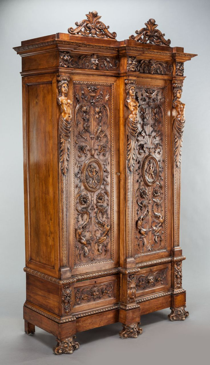 Furniture : Continental, A TUSCAN CARVED WALNUT ARMOIRE. 19th Century. 95 1
