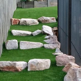 Unique Artificial Turf down the side of a house.