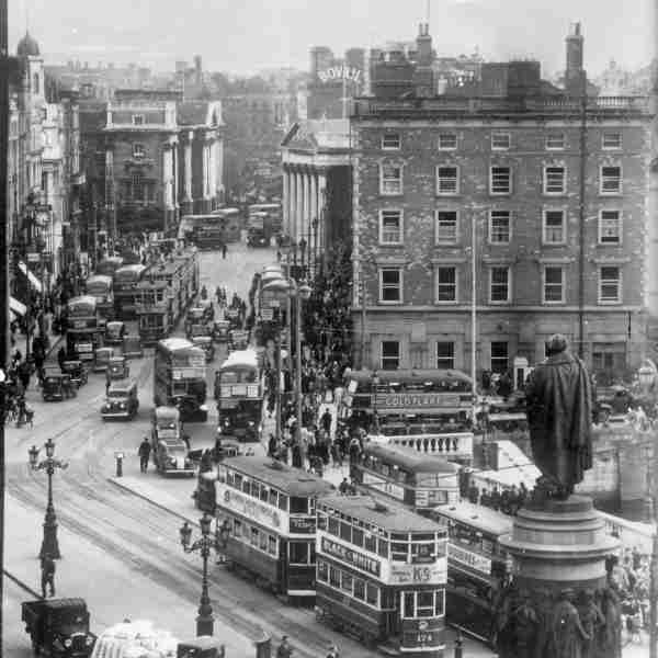 O'Connell Bridge (c.1940)  Elevated view of O'Connell Bridge looking towards Westmoreland Street with the Daniel O'Connell statue in the foreground.  © Courtesy of The National Library of Ireland
