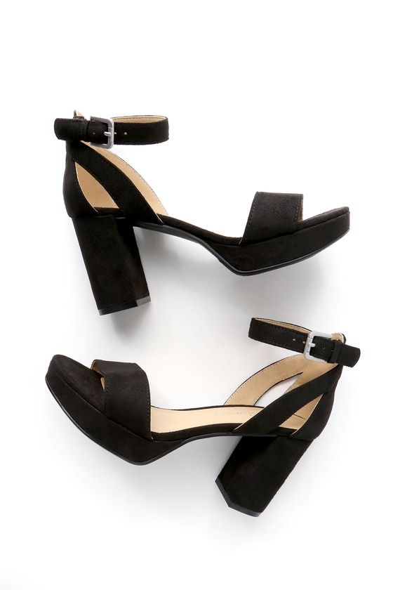 """Once you start, you won't be able to stop ... talking about how cute the CL by Laundry Go On Black Suede Platform Ankle Strap Heels are! Soft, vegan suede covers these brag-worthy platform heels with a wide peep-toe strap, heel cup with cutout detail, and adjustable ankle strap (with gold buckle). 1"""" toe platform."""