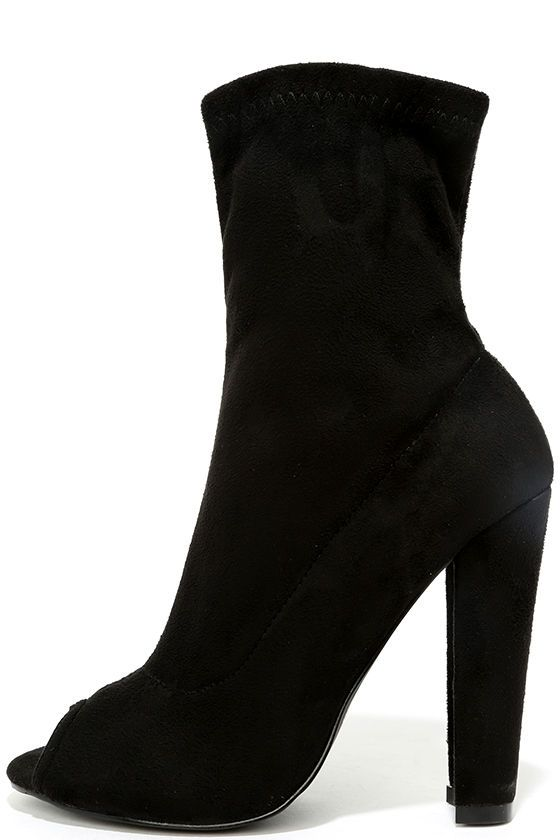 "We're singing the praises of the Kehlani Black Suede Peep-Toe Booties! Velvety vegan suede forms a sexy peep-toe upper and trendy sock boot silhouette complete with a fitted mid-calf shaft. 7.5"" zipper at the instep."