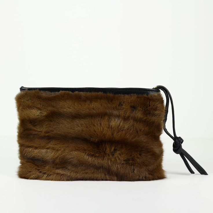Repurposed vintage fur and leather clutch bag // reMade USA by Shannon South // made in USA #recycled #upcycled