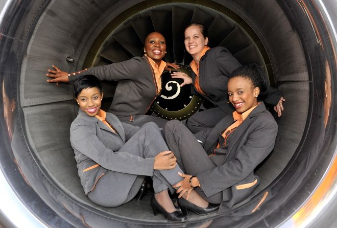 Just 4 Mango Airlines air hostesses relaxing inside the engine of a Boeing 737-800