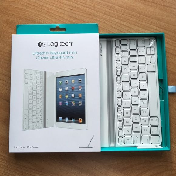 Logitech iPad mini keyboard Logitech Ultra thin keyboard in white. Attached magnetically. Comes with original box and charging cord. Logitech Accessories