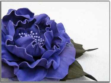 Handcrafted leather rose in electric blue-purple on DaWanda.    (accessories, brooches, clips)  http://en.dawanda.com/product/40217502-Leather-flower-hair-clips-and-brooch-2x1-