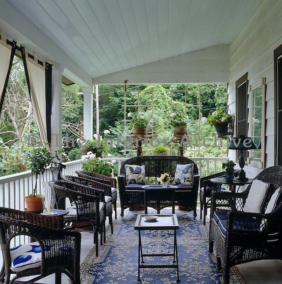 Amazing The Veranda Is Filled With Black Wicker Furniture Upholstered In A Variety  Of Blue And White