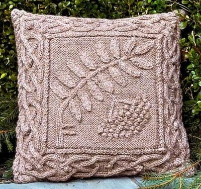 """The Celtic Rowan Pillow.  The ancient Celts prized the oak over other trees and today the oak wood is still prized for its hard wood and natural beauty. Each few (letter) of the ancient Irish writing called Ogam (pronounced owam) is associated with a sacred tree. The Ogam few called """"duir"""" represents the oak and is incorporated on this pillow pattern. This design is one in a series of Celtic botanical knits created to draw attention to the beauty of our planet."""
